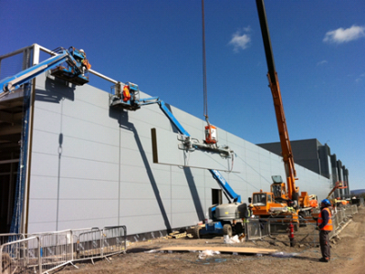 Installation of heavy cladding panels.png