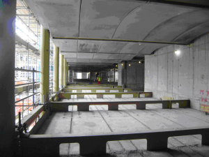 Fig 3 Exposed concrete floors supported on steel beams and used to provide thermal mass.png