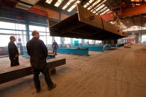 Handling steelwork in the factory.jpg